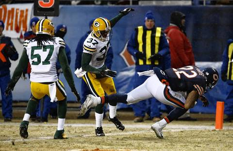 Chicago Bears running back Matt Forte (22) dives for a touchdown after a catch in front of Green Bay Packers cornerback Sam Shields (37) and Green Bay Packers inside linebacker Jamari Lattimore (57) in the first quarter at Soldier Field.