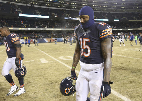 James Anderson (50) and Brandon Marshall leave the field following their team's loss.