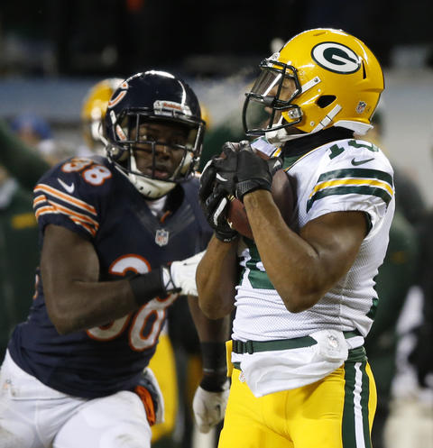 Packers wide receiver Randall Cobb catches a ball in front of cornerback Zack Bowman before running in for the game-winning touchdown.