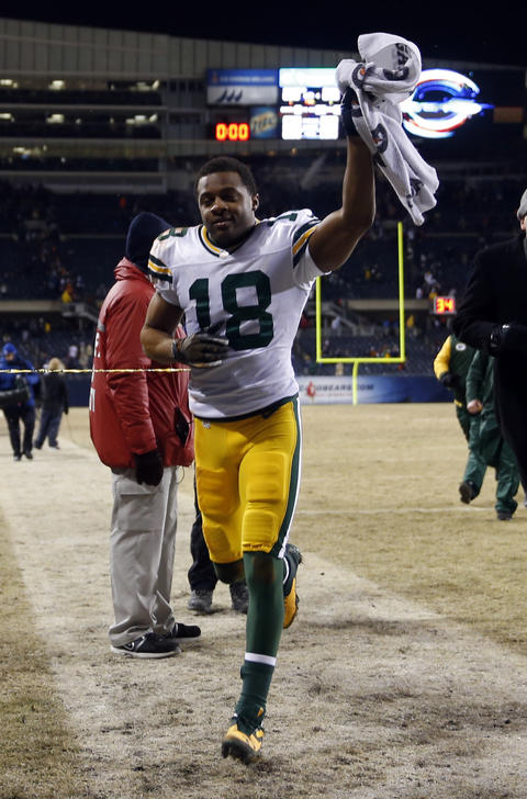 The Packers' Randall Cobb celebrates while leaving the field.