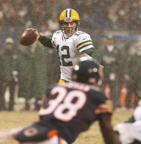 Packers quarterback Aaron Rodgers looks before throwing a pass during the first half.