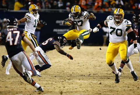 JOSE´ M. OSORIO: I like the elements of all the players doing something different and the height of Green Bay Packers running back Eddie Lacy (27) who is trying to jump over Chicago Bears cornerback Tim Jennings.