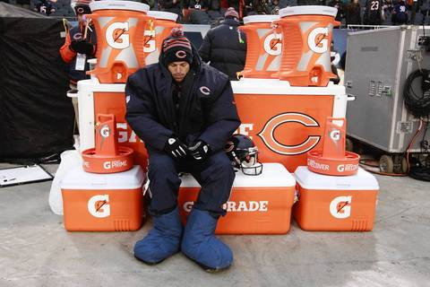 Chicago Bears kicker Robbie Gould (9), stays warm on the bench before the start of his team's game against the Green Bay Packers at Soldier Field on Sunday.