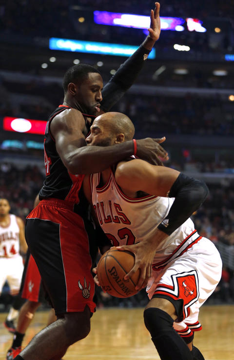 Taj Gibson's path to the basket is blocked by the Raptors' Patrick Patterson in the 1st quarter.