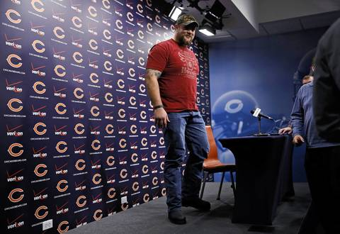 Chicago Bears left guard Matt Slauson leaves after speaking to the media at a press conference regarding his contract extension at Halas Hall in Lake Forest on Thursday.