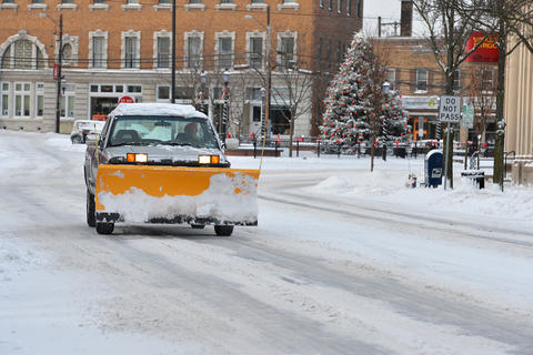Plow trucks work their way through in Emmaus on Friday, January 3 during the first snow storm of 2014.