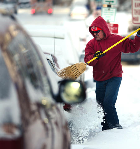 "John Johnson of Chew Street clears snow from his car early Friday.    A snowstorm left about 6 - 8"" in the Lehigh Valley."