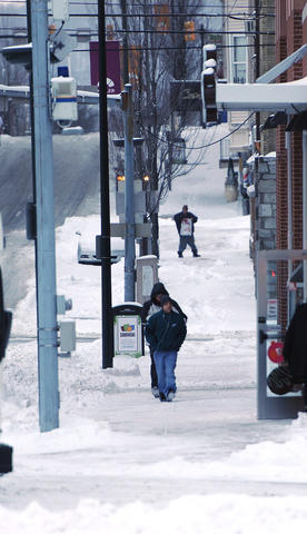"A snowstorm left about 6 - 8"" in the Lehigh Valley. People walk along N. 6th Street early Friday."