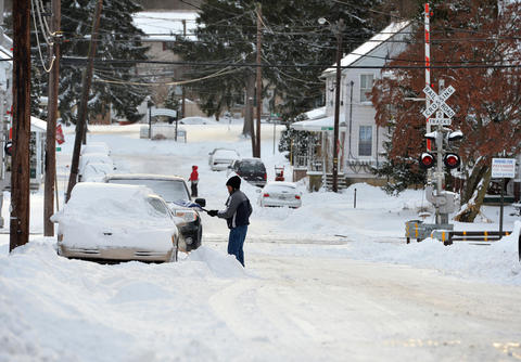 People dig out their cars in Emmaus on Friday, January 3 during the first snow storm of 2014.