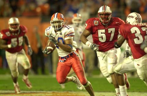 Maryland's Randy Starks (57) pursues Florida's Jabar Gaffney.