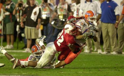 Maryland's Leon Joe (32) and Tony Okanlawon tackle Florida's Taylor Jacobs.