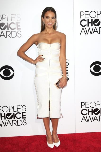 Actress Jessica Alba in a strapless white bustier dress by Jason Wu and pumps by Casadei.