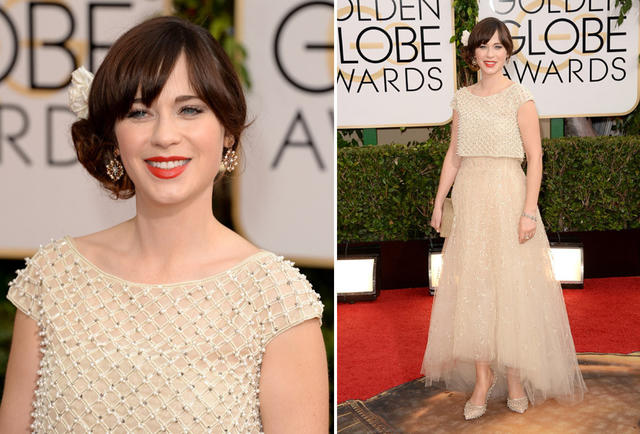 """New Girl"" actress Zooey Deschanel wears an ivory tulle Oscar de la Renta gown."