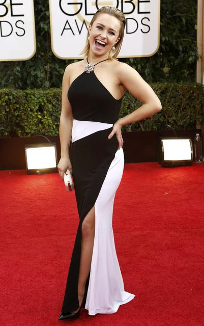 Hair slicked back in white and black, Hayden Panettiere wears Tom Ford.