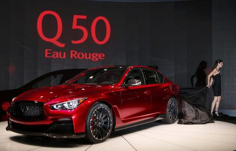 Models unveil the Infiniti Q 50 Eau Rouge sedan during the press preview day of the North American International Auto Show in Detroit, Michigan January 14, 2014.