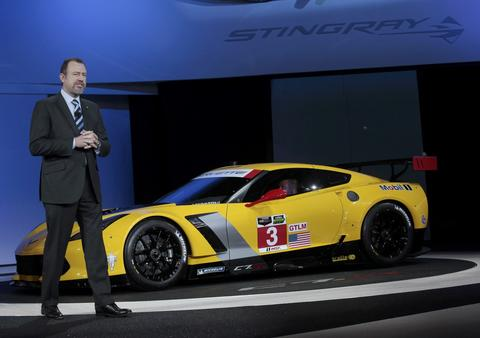 Daniel Ammann, President of GM, speaks next to the Chevrolet Corvette Stingray C7R racing version during the press preview day of the North American International Auto Show in Detroit, Michigan January 13, 2014.