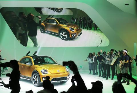 Members of the Detroit World Choir perform as the Volkswagen Beetle Dune concept is unveiled during the 2014 North American International Auto Show in Detroit, on Monday, Jan. 13, 2014.