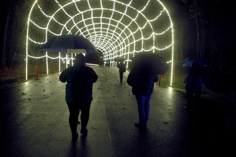 Photo Of The Week: Nov 23-Nov 29, 2013    Guests walk through Newport News Park Tuesday evening during the walking tour of the Celebration of Lights at Newport News Park. The walk is a fund-raising event for the Center for Child & Family Services.