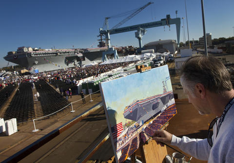 Photo Of The Week: Nov 2-Nov 8, 2013 Brian Murphy, an artist from Newport News, paints the scene of Saturday's christening ceremony for the aircraft carrier Gerald R. Ford.