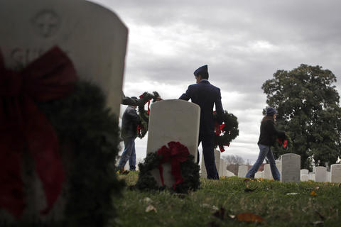 Photo Of The Week: Dec 14-Dec 20, 2013   Military and community members lay wreaths at Hampton National Cemetery Saturday afternoon as part Wreaths Across America.