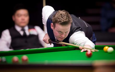 England's Shaun Murphy plays a shot during his first round match against China's Ding Junhui on day three of the Masters Snooker tournament at Alexandra Palace in London on January 14, 2014.