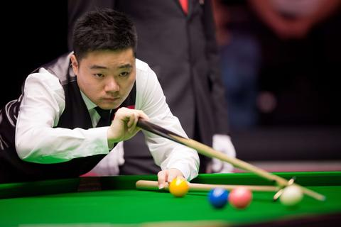 China's Ding Junhui plays a shot during his first round match against England's Shaun Murphy on day three of the Masters Snooker tournament at Alexandra Palace in London on January 14, 2014.