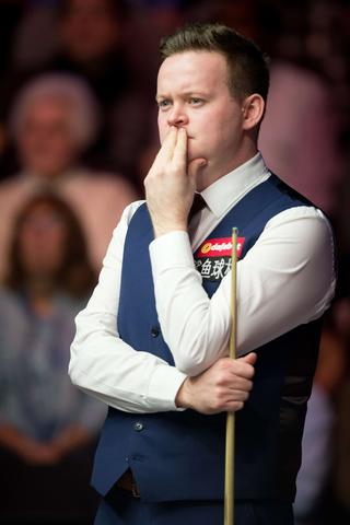 Britain's Shaun Murphy looks on during his match against Ding Junhui of China on day three of the Masters Snooker tournament at Alexandra Palace in London, on January 14, 2014.