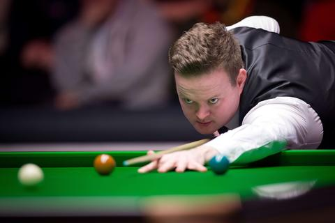 Britain's Shaun Murphy plays a shot during his match against Ding Junhui of China on day three of the Masters Snooker tournament at Alexandra Palace in London, on January 14, 2014.