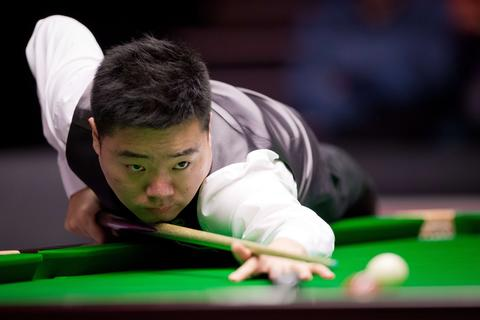 Ding Junhui of China plays a shot during his match against Britain's Shaun Murphy on day three of the Masters Snooker tournament at Alexandra Palace in London, on January 14, 2014.