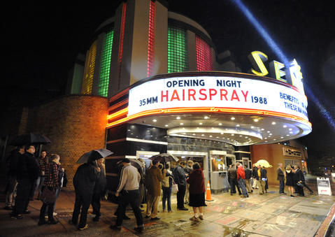 "A crowd gathers outside the Senator Theatre on the night of its reopening, which featured a sold-out showing of John Waters' ""Hairspray."""