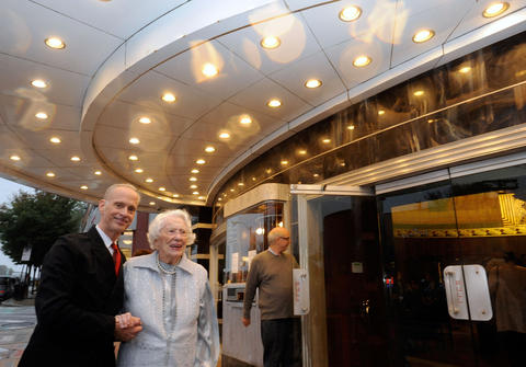 "Filmmaker John Waters arrives with his mother, Patricia Waters, for the reopening of the newly renovated Senator Theatre. The night featured a showing of Waters' film ""Hairspray,"" in honor of its 25th anniversary."