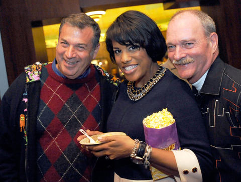 From left, Ted Frankel, of Baltimore, Mayor Stephanie Rawlings-Blake and Bill Gilmore, director of the Baltimore Office of Promotion and the Arts, stand together at the Senator Theatre grand reopening.