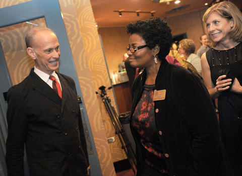 Filmmaker John Waters, left, talks with Delegate Mary Washington, second from left, at the reopening of the newly renovated Senator Theatre.