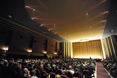 A packed house listens to filmmaker John Waters speak during the reopening of the newly renovated Senator Theatre.