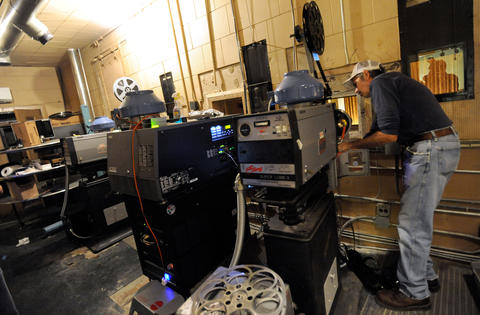 "Projectionist Dominic Wagner of Baltimore works to get John Waters' ""Hairspray"" on the screen for the reopening of the newly renovated Senator Theatre."