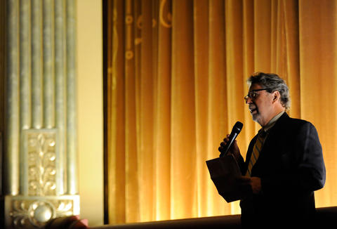 "Senator Theatre co-owner James ""Buzz"" Cusack speaks at the venue's grand reopening."