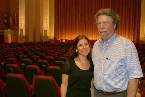 Buzz Cusack and his daughter, Kathleen Cusack Lyon, stand in the Senator Theatre's renovated main room.
