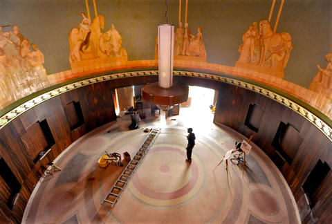 Renovations -- including restored murals and walnut paneling --  underway at the Senator Theatre.