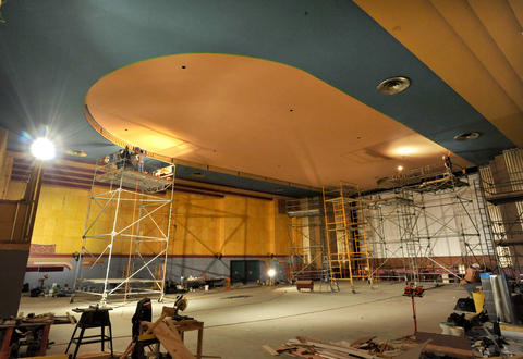 Renovations continue at the Senator Theatre. Artists paint designs on the ceiling return.