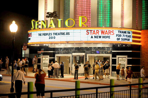 "Shown is the last crowd of Tom Kiefaber's reign as Senator Theatre owner, departing the movie house after the showing of "" Star Wars."" Kiefaber is also shown outside greeting the folks leaving."