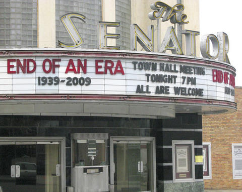 The marquee on The Senator theatre announces its demise.