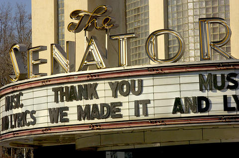 "The marquee on the Senator Theatre reads: ""Thank You, We Made It,"" after owner Tom Kiefaber raised enough money to pay off his debt and staved off a foreclosure auction on the historic movie house."