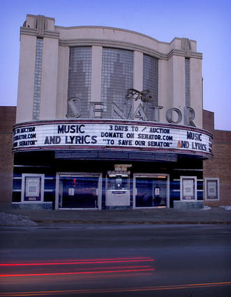 A sign on the Senator's marquee counts down to the historic theater's possible sale at auction.