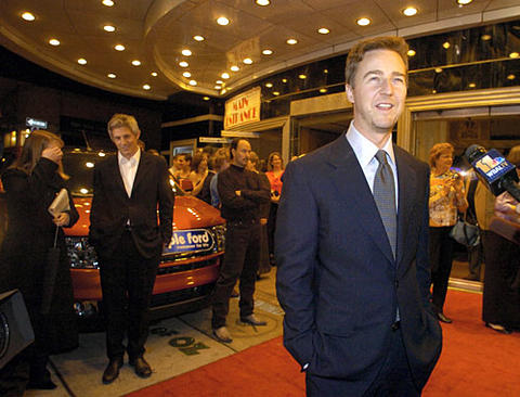 "Actor Ed Norton talks with the news media at a benefit screening of ""The Painted Veil"" at the Senator Theatre."