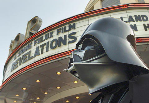 "A fan dressed as Darth Vader stands outside the Senator Theatre for the premiere of ""Revelations,"" a ""Star Wars"" documentary."