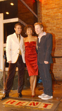 "Co-stars of the movie ""Rent"" -- Wilson Jermaine Heredia, Tracie Thoms and Anthony Rapp -- stand outside the Senator Theatre before the premiere of the movie."