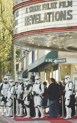 "Storm troopers guard the entrance to the Senator Theatre as York Road was taken over by people dressed as Star Wars characters to mark the debut of the movie, ""Revelations."""