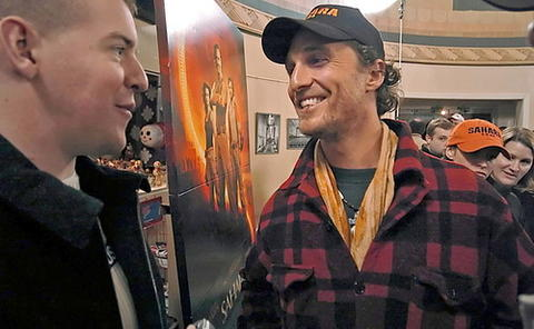 "Ryan Sargent of New York, whose ankle was injured in the explosion of an improvised explosive device during the Iraq War, chats with Matthew McConaughey during a pre-screening of the motion picture ""Sahara"" at the Senator Theatre."