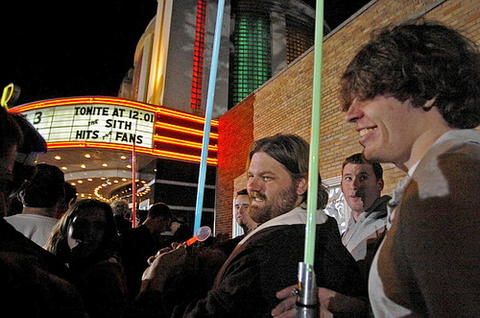 "Fans gather outside the Senator Theatre before the premiere of ""Star Wars Episode III: Revenge of the Sith."""