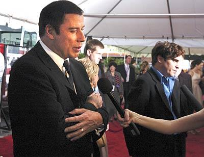 """Ladder 49"" stars John Travolta and Joaquin Phoenix answer questions before the movie's premiere at the Senator Theatre."